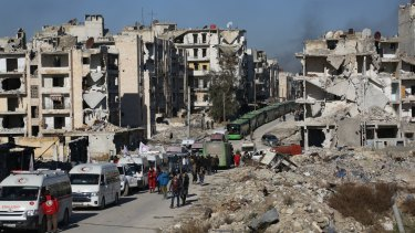 A convoy including buses and ambulances waits at a crossing point to evacuate civilians trying to flee Aleppo last week.