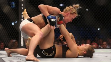 Brutal: Holly Holm takes it to previously undefeated champion Ronda Rousey in Melbourne last November.