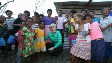 Foreign Minister Julie Bishop meets with locals during a visit to bring Australian aid to Fiji after Tropical Cyclone Winston.