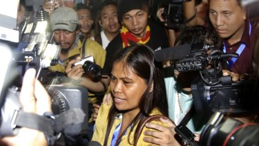 Marites Veloso, sister of Filipina Mary Jane Veloso, talks to the media after visiting her sister on Wednesday.