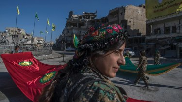 Fighters from the Kurdish  YPJ militia hold a celebration in Paradise Square in Raqqa.