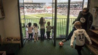 A kindergarten class watches preparations for a match from a classroom inside the FC St. Pauli soccer team's stadium in Hamburg, Germany.