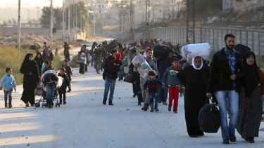 Syrians flee rebel-held eastern neighbourhoods of Aleppo into the Kurdish-controlled Sheikh Maqsoud district of the city last month.