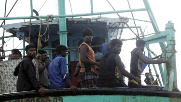 Sri Lanka refugees wait for help from the Indonesia Government after their wooden boat drifted off the Indonesian coast, on Saturday.