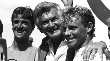 Prime Minister Bob Hawke with surfers Barton Lynch (left) and Tom Carroll (right), at Bondi Beach in 1984.