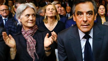 Francois Fillon, right, with his wife Penelope during a rally of his Republican Party in Paris in November.