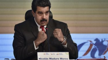 Venezuelan President Nicolas Maduro gestures during a meeting with mining companies in Caracas.