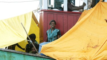 The boat is carrying 44 men, women and children, including a pregnant woman.