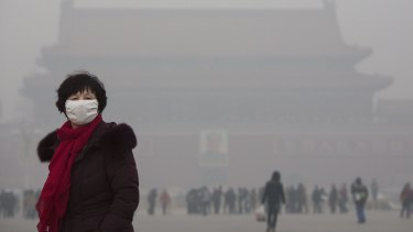 Heavy pollution in Tiananmen Square, Beijing. Federal Minister of the Environment Greg Hunt says there will be no global emissions agreement without India.