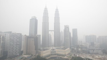 Malaysia's landmark Petronas Towers and other commercial buildings are seen shrouded with haze in the Malaysian capital, Kuala Lumpur.