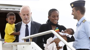 Mariam Yahya Ibrahim arrives at a military airfield outside Rome with her daughter Maya in her arms  and son Martin accompanied by Italian deputy Foreign Minister Lapo Pistelli.