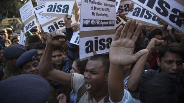 Protestors from All India Students Association (AISA) demonstrate outside the Delhi Police headquarters after an Uber driver allegedly raped a young woman.