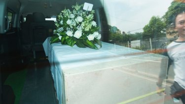 Andrew Chan's coffin leaves a funeral home in Jakarta.