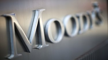 Moody's says Canberra needs to increase taxes because spending cuts have not been deep enough.