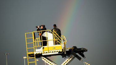 Security agents scan the horizon as Barack Obama arrives in Ethiopia aboard Air Force One.