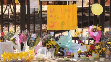 Messages from friends, students and the community were placed outside the Leeton school gate.