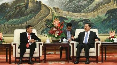 Philippines President Rodrigo Duterte, left, meets top Chinese parliamentarian Zhang Dejiang in Beijing in October.