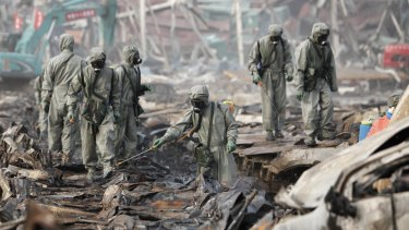 Rescuers spray hydrogen peroxide at the site of Tianjin warehouse explosion.