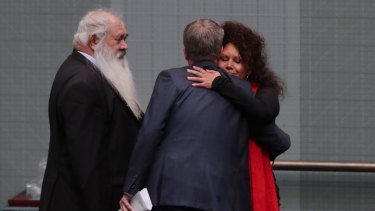 Bill Shorten hugs Senator Malarndirri McCarthy after Malcolm Turnbull delivered the Closing the Gap report at Parliament House.