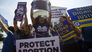 Pro-choice activists celebrate at the Supreme Court on Monday.