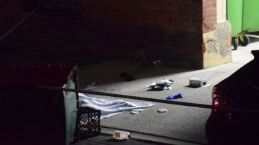 A man's body covered with a blanket in Dath St, Teneriffe.