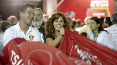Supporters of the left-wing Syriza party react after the election results in Athens on Sunday.