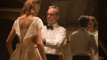 Vicky Krieps, left, and Daniel Day-Lewis in a scene from <i>Phantom Thread</i>.