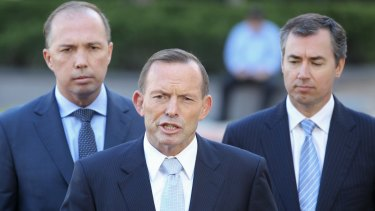Prime Minister Tony Abbott, flanked by Immigration Minister Peter Dutton and Justice Minister Michael Keenan on Wednesday.