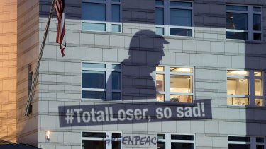 A Greenpeace banner showing US President Donald Trump is projected onto the facade of the US Embassy in Berlin, on Friday.