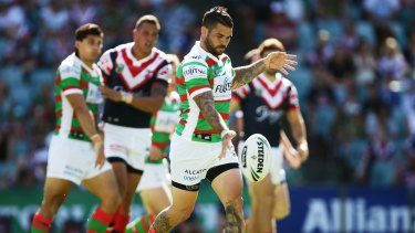 Ball on a string: Adam Reynolds kicks during the round one NRL match between the Sydney Roosters and the South Sydney Rabbitohs at Allianz Stadium.