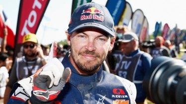 Number one: Toby Price celebrates winning the Dakar Rally.