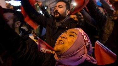 Protesters sing and chant outside the Dutch consulate in Istanbul after Turkey's foreign minister was turned away from the Netherlands.