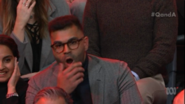 Tarang Chawla reacts in shock as Steve Price responds to his question on <i>Q&A.</i>