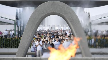 People offer prayers at the Peace Memorial Park in Hiroshima on the 72nd anniversary of the atomic bombing.