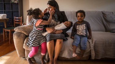 Karina Okotel with her children Hannah, 3, David, 2, and nine-week-old Grace.