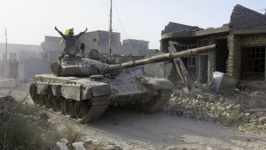 An Iraqi forces tank moves into Fallujah, Iraq.