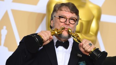 Guillermo del Toro with the Oscars for best director and best picture for <i>The Shape of Water</i>.