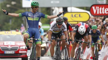 Australia's Michael Matthews (left) celebrates as he crosses the finish line head of Peter Sagan of Slovakia, (centre) and Norway's Edvald Boasson Hagen (right) to win the tenth stage.