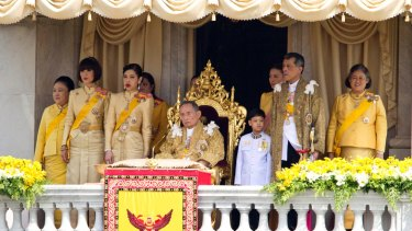 The late king is flanked by his family, including then Crown Prince Maha Vajiralongkorn, second from right, and Princess Maha Chakri Sirindhorn, first right, in December 2012.