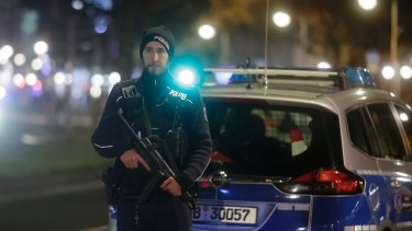 A police officer stands guard after a truck ran into a crowded Christmas market in Berlin.