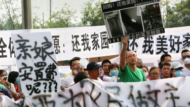 A protest in front of Tianjin TEDA Convention Centre Hotel on Wednesday.