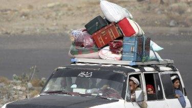 People flee the Yemeni capital Sanaa with their belongings fearing renewed air strikes.