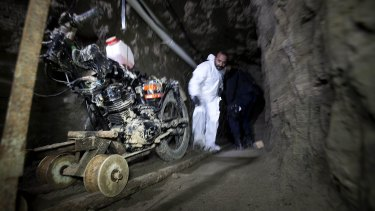 """A motorcycle adapted to a rail sits in the tunnel under the half-built house where drug lord Joaquin """"El Chapo"""" Guzman made his escape from the Altiplano maximum security prison in Almoloya, west of Mexico City in July 2015."""
