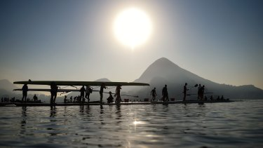 Rowers carry their boats before a training session at the World Rowing Junior Championships at Lagoa Rodrigo de Freitas  in Rio de Janeiro on Wednesday last week.