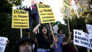 """In the US, his rhetoric on Mexicans has activated and alienated a key constituency ahead of the presidential elections. """"A la basura"""" is Spanish for """"in the bin""""."""
