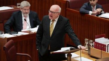 Attorney-General George Brandis attacks Pauline Hanson for wearing the burqa in the Senate.