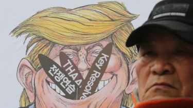 A South Korean protester attends a rally to oppose the joint military exercises, dubbed Key Resolve and Foal Eagle, last week.