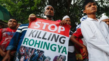 A Rohingya holds a banner during protest after Friday prayers outside the Myanmar embassy in Kuala Lumpur, Malaysia,  in November.