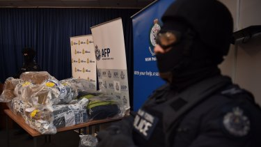 AFP officers stand guard over some of the 500 kilograms of cocaine seized during the Christmas Day bust in NSW.