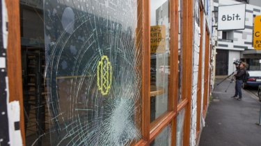 Sixteen window panels were smashed at 8-Bit over the New Year's Eve weekend. The burger restaurant has been targeted again.